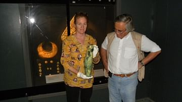 Professor Theodore Antikas with Laura-Wynn Antikas Holding the Shorter Greave from the Royal Tomb of Vergina