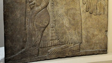 An Assyrian Apkallu Carrying a Goat