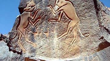 Saharan Rock Carving of Two Cats Fighting
