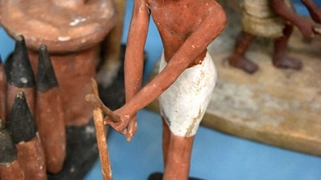 Egyptian Statuette of a Peasant Using a Hoe