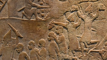 Assyrian Soldiers Holding Decapitated Heads of Nubian Soldiers