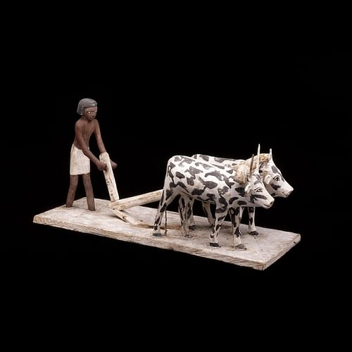 Wooden model of a man ploughing with oxen