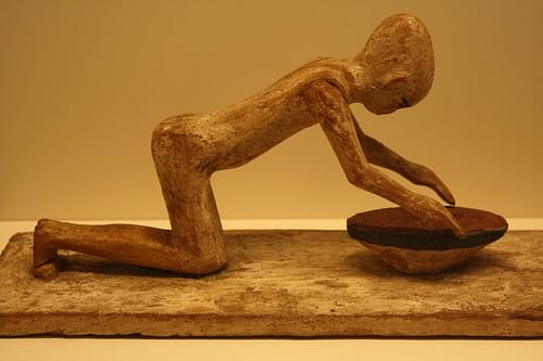 Egyptian Wooden Statue of a Woman Grinding Cereals