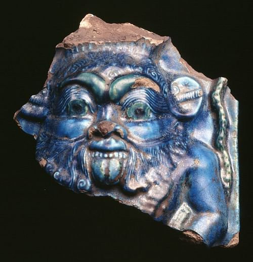 Bes, Blue Glazed Relief (by The Trustees of the British Museum)