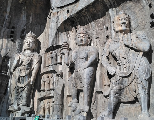 Longmen Grottoes - Attendants at Fengxiansi Cave (by Benjamin Oswald)