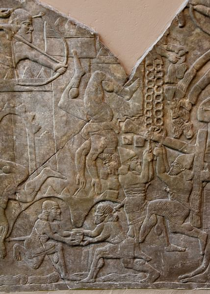 Assyrian Soldiers Attacking a City