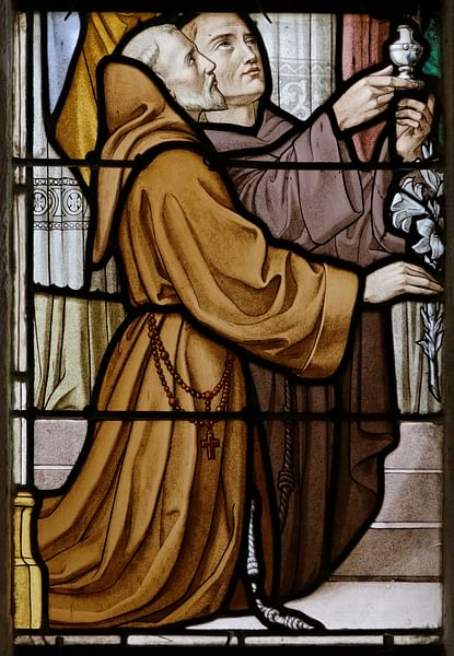 A Stained Glass Window Showing Two Franciscan Monks