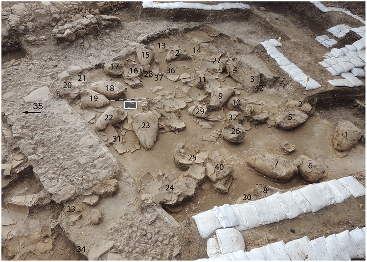 2013 image of labelled wine jars in first Tel Kabri wine cellar towards the southeast (Eric H. Cline)