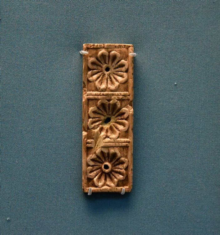 Small Nimrud Ivory Panel of Three Rosettes