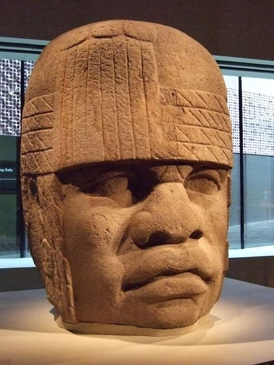 write a two-paragraph essay that describes the ways of life of the olmec and the zapotec