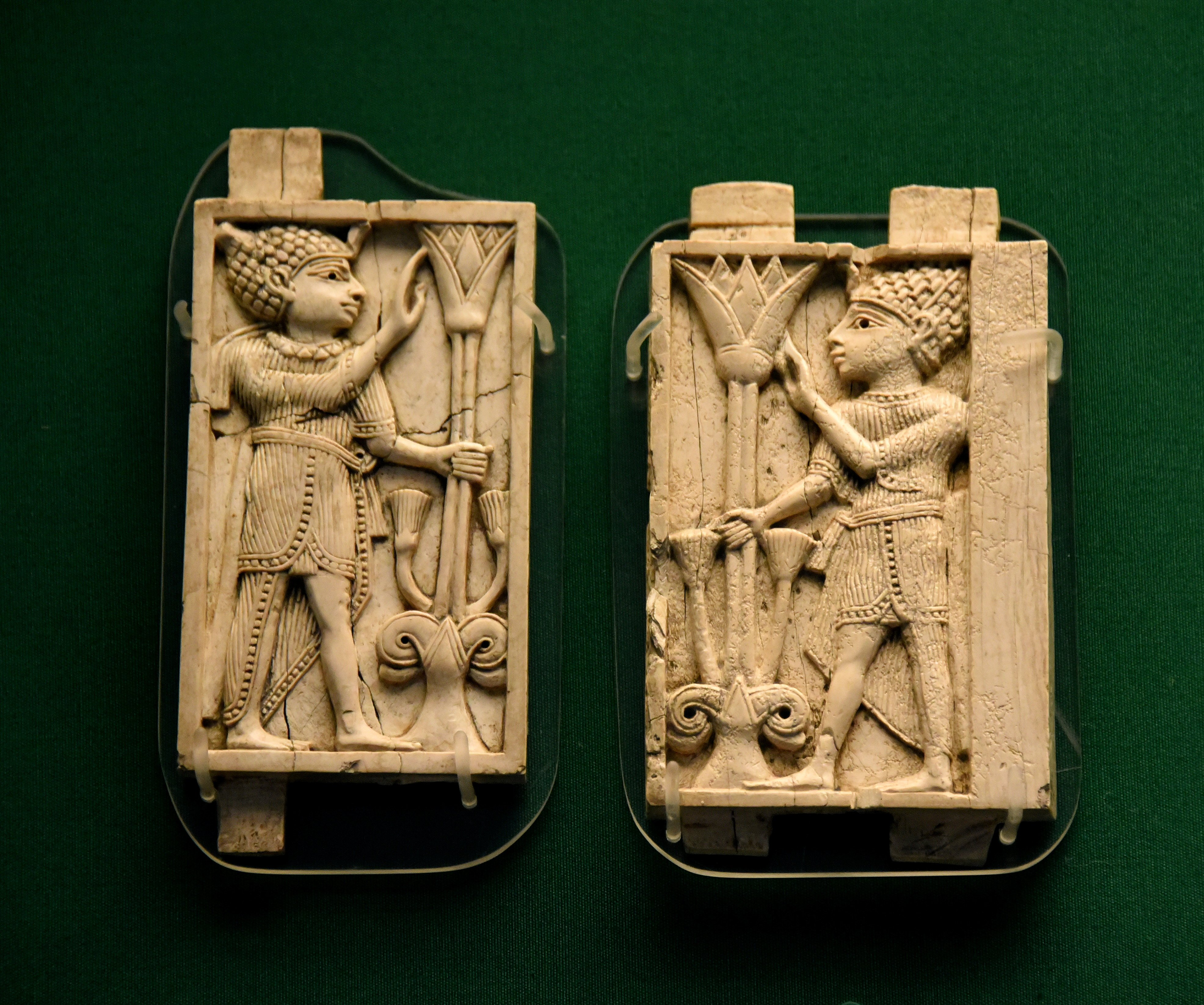 Nimrud ivory panels of two egyptian kings illustration ancient two panels from a much larger composition each showing a youth dressed in egyptian royal costume grasping a tree formed by a lotus flower arising from a izmirmasajfo