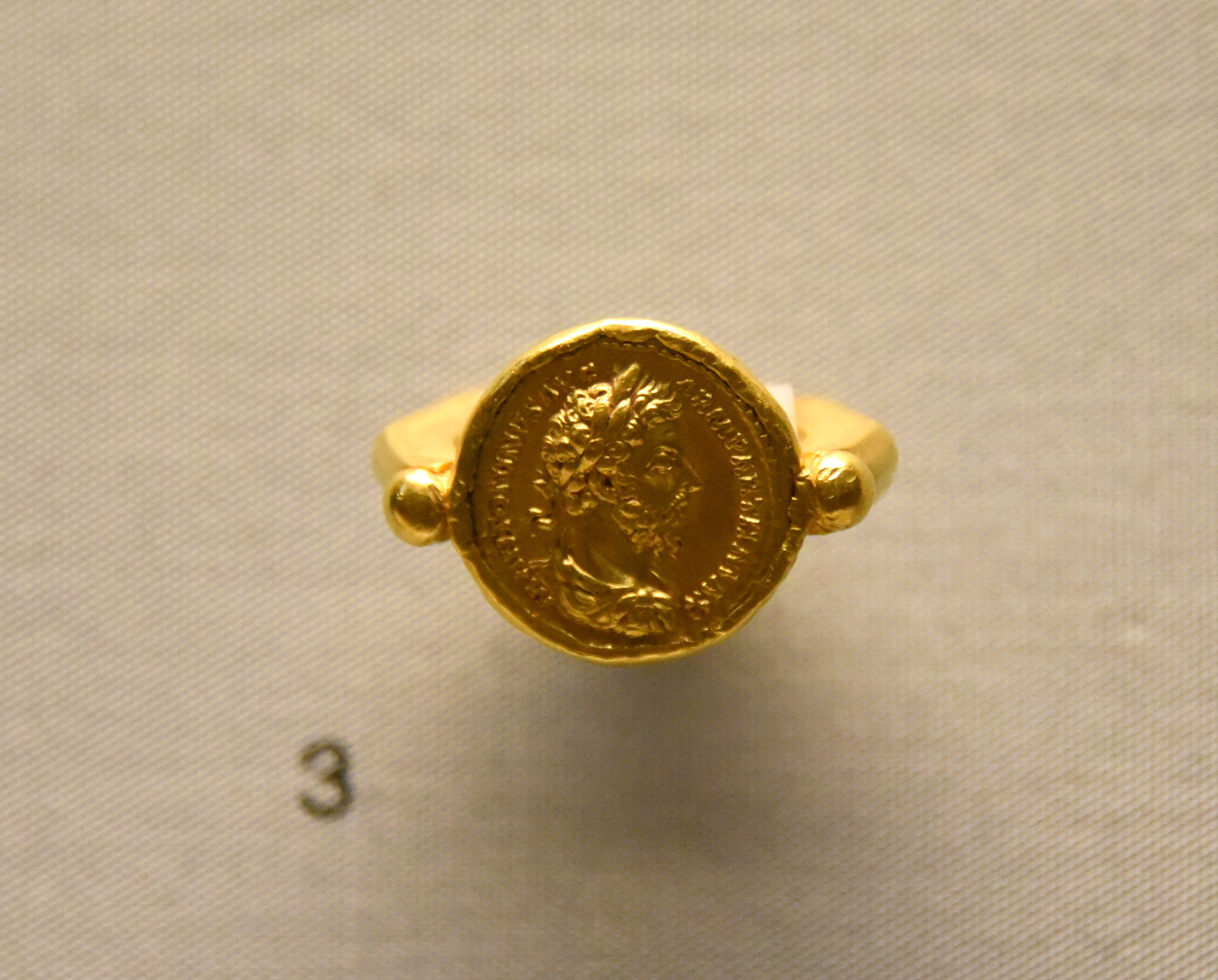 Ancient Roman Rings gold ring with coin of emperor marcus aurelius (illustration